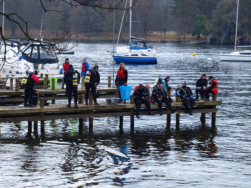 divers on pier