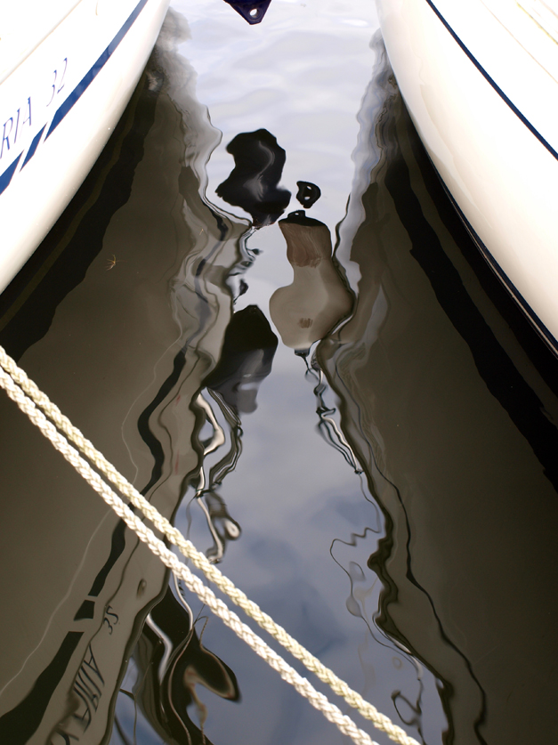 reflection between boats